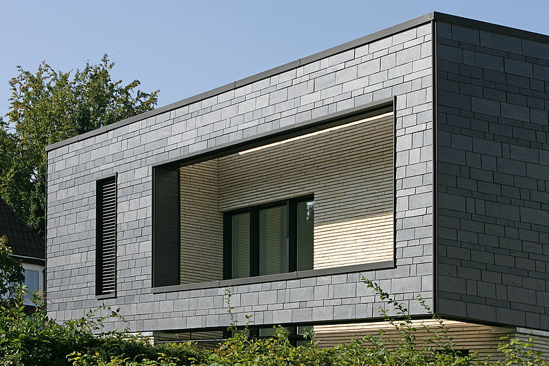 Fassaden aus Naturschiefer - Dynamische Deckung